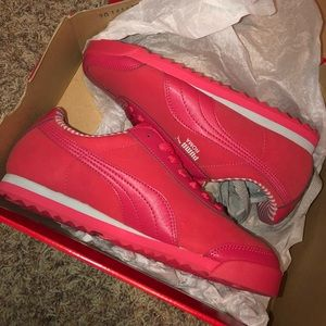 Women's Red puma sneakers.